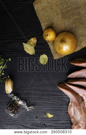 Raw Pork Or Beef Tongues With Black Pepper In Glass Jar, Onion On Sackcloth, Cress Salad On Black Wo