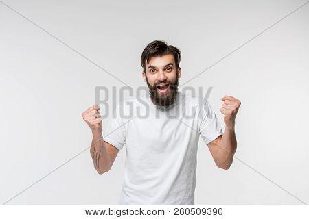 I Won. Winning Success Happy Man Celebrating Being A Winner. Dynamic Image Of Caucasian Male Model O