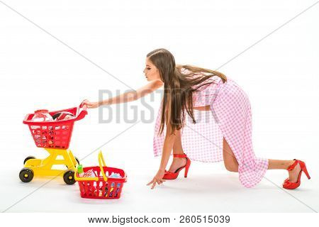 Woman Going To Make Payment In Supermarket. Shopping Girl With Full Cart. Retro Woman Go Shopping. S
