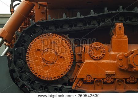 Fragment Of Caterpillars Of A Heavy Bulldozer For Emergency Repair Works, Standing On A Railway Flat