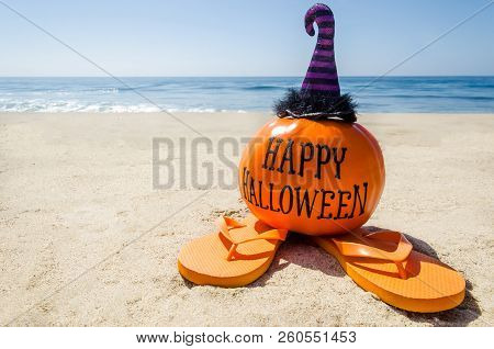 Beach Halloween Background With Pumpkin In The Witch's Hats