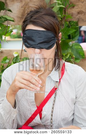 A Woman With Hidden Eyes Makes A Blind Tasting Of Wine