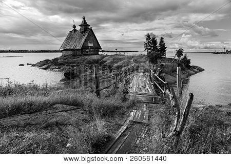 Old Russian Orthodox Wooden Church In The Village Rabocheostrovsk, Karelia. Abandoned Church On The