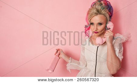 Puppet Depression. Cool Young Woman With Colored Hair. Stylish Hairstyle, Informal Style. Pink Backg