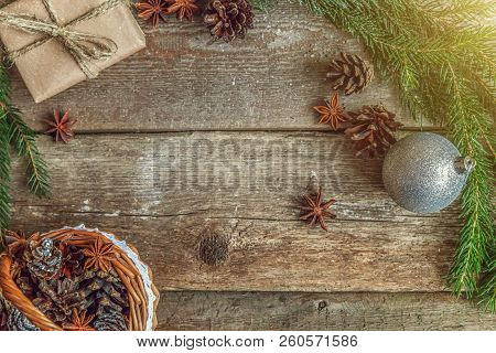 Christmas New Year Composition With Gift Box Fir Branch Basket Pine Cones On Old Shabby Rustic Woode