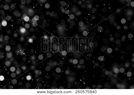 Falling Down Real White Snowflakes On Black Background. Isolated Snowfall Calm Snow Minimalistic Des