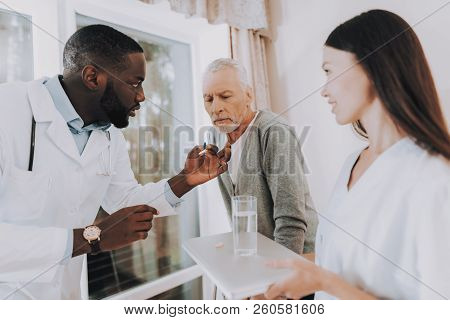 Patient With Walker. Take Pills. Man Hears. Very Focused. Nursing Home. Cure. Glass Of Water. Doctor