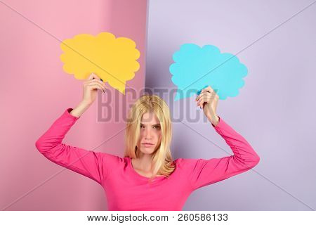 Casual Woman Holds Speech Bubbles. Girl In Pink Pullover Holds Speech Bubble. Beautiful Woman With B
