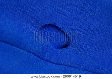 Blue Cloth Texture With A Big Hole On The Fabric