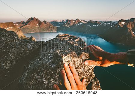 Man Hands Climbing Up To Mountain Summit Travel Adventure Active Lifestyle Extreme Vacations In Norw