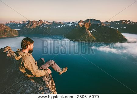 Man Tourist Sitting Alone On The Edge Cliff  Mountains Above Sea Travel Adventure Lifestyle Extreme