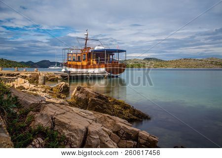 Isolated Boat Stopped And Anchored In The Calm Waters And Colorful, Kornati Islands, Dalmatia, Croat