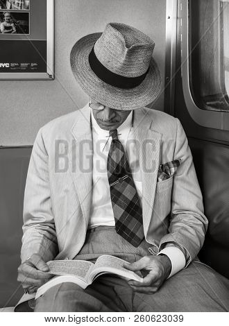 New York, Usa - Sep 22, 2017: Black And White Image Of New York City Subway. An Elderly Man In Glass