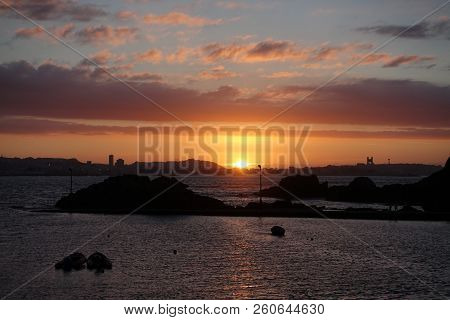Sunset And Skyiline Of The City Of La Coruna In Spain Seen From The Other Side Of The Bay In The Tow