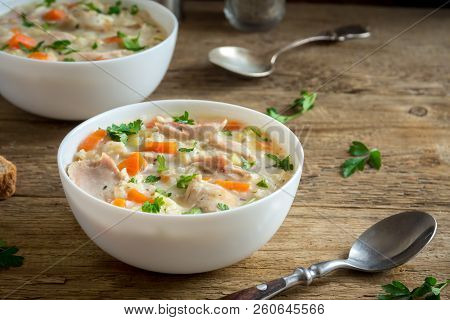Chicken And Wild Rice Soup. Homemade Fresh Creamy Soup With Chicken, Vegetables And Wild Rice In Whi