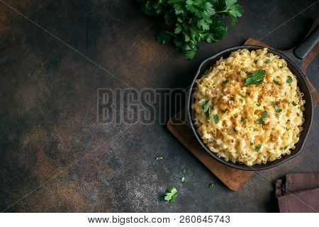 Mac And Cheese, American Style Macaroni Pasta With Cheesy Sauce And Crunchy Breadcrumbs Topping On D