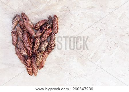 Fir-tree Cones In A Shape Of Heart On Rough Surface.