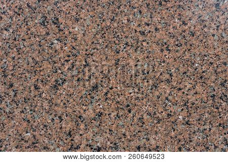 Burnished pink granite texture close up view. Background. poster