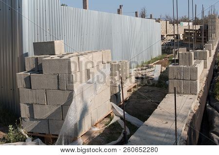 Construction Of A Brick Fence. Construction Of The Foundation. Laying A Brick Fence. Construction Wo