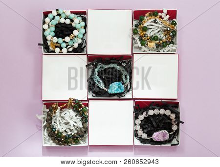 Set Of Multicolor Handmade Bracelets With Gems In White Boxes With Empty Places For Your Text, Lying