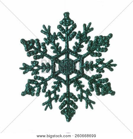 Green Decorative Christmas Snowflake Isolated On White Background.