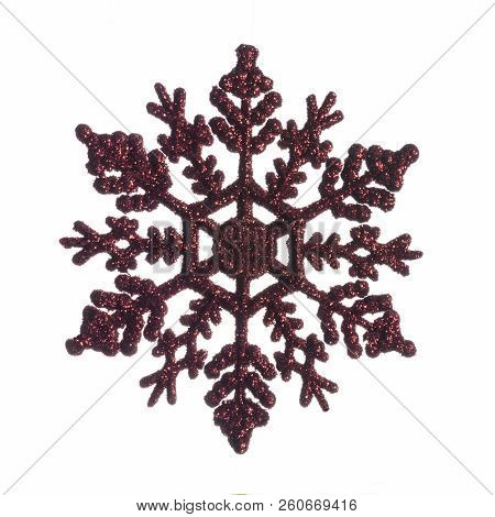 Red Decorative Christmas Snowflake Isolated On White Background.