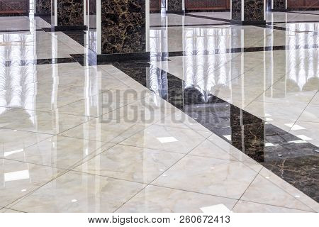 Marble Floor In The Luxury Lobby Of Office Or Hotel. Real Floor Tile Pattern With Reflections For Ba