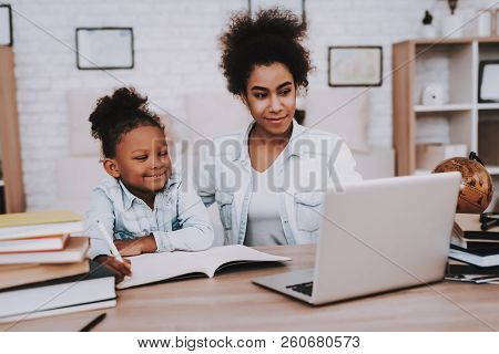 Mulatto Girl And Mulatto Mother Time Together. Tablet And Mother With Daughter. Lessons For Little G