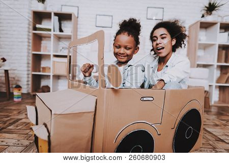 Happy Time With Family. Mom And Daughter Drive Car Together. People And Car. Childhood With Mother.