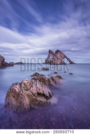 Bow Fiddle Rock - A Natural Sea Arch Near Portknockie On The North East Coast Of Scotland