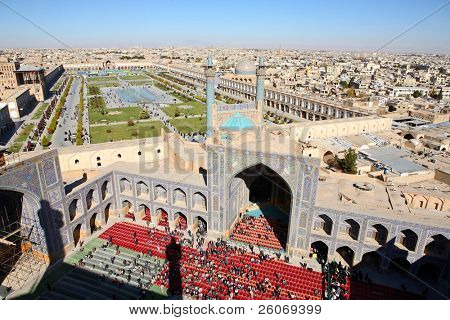 Half an hour before a Muslim Friday mass prayer in Imam Mosque in Isfahan, Iran. Aerial view on Isfahan. The image was taken from the top of minaret.