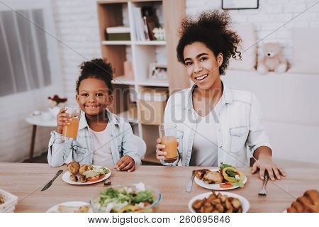 Happy Girl Eat And Drink Juice Happy Family Time Together. Child And Happy Girl. Baby And Young Moth