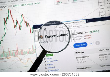 Montreal, Canada - September 8, 2018: Decentraland Altcoin Site Under Magnifying Glass. Blockchain I