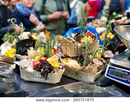 BOROUGH MARKET, LONDON - SEPTEMBER 28, 2018: Wild mushrooms for sale by the punnet at Borough Market in London Bridge, London, UK.