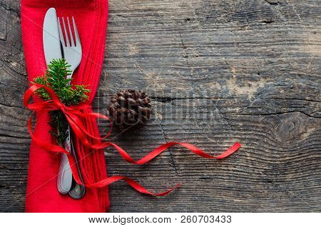 Festive Place Setting For Christmas Dinner On Old Wooden Background. Christmas Table Setting With Re
