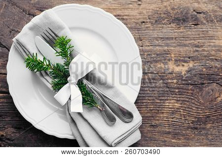 Festive Place Setting For Christmas Dinner On Old Rustic Background. Christmas Table Setting In Scan