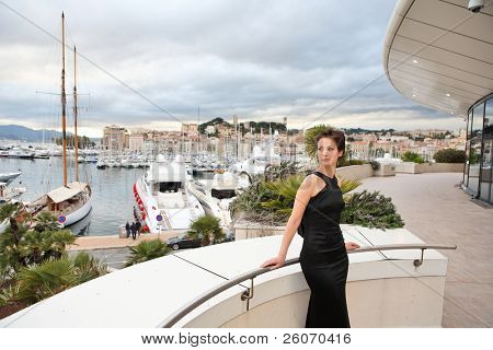 Beautiful model on the balcony of Palais des Festivals in Cannes, France