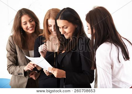 Young Smiling Business Women Working New Project At Office.coworkers Team At Business Meeting Lookin