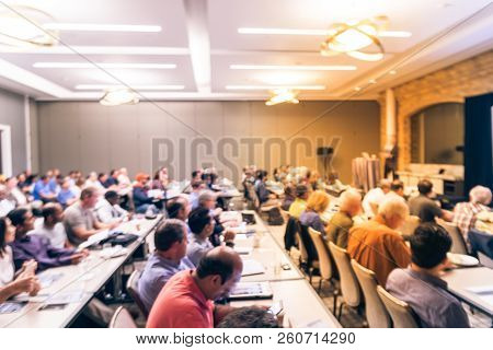Blurry Background Speaker Giving A Talk At Business Meeting In America