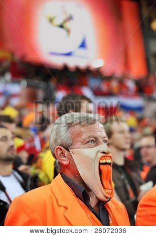 JOHANNESBURG - JULY 11 :  Final at Soccer City Stadium: Spain vs. Netherlands on July 11, 2010 in Johannesburg.  Dissapointed Dutch supporter