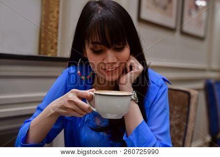 Restaurant Concept. Asian Women Eating In Restaurant. Asian Women Are Happy To Eat. Asian Women Rela