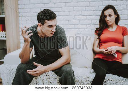 Husband. Man Smoking Cigarette. Depressed. Motherhood. Sickness. Pregnant Girl. Pain. Home. Bad Habi