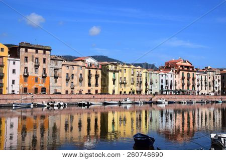 Panoramic View On The Boats On The River Temo In Bosa In Sardinia Including Typical Colorful Italian