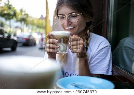 Cute Pretty Young Woman Drinks Coffee Milk Foam