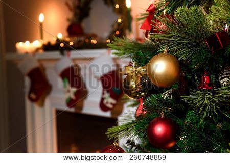 Beautiful Decorated Fireplace And Christmas Tree At Cottage. A Rich Christmas Tree With Lots Of Hang