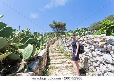 Apulia, Grotta Zinzulusa, Italy - A Young Woman Walking Up The Stairway At The Grotto Of Zinzulusa