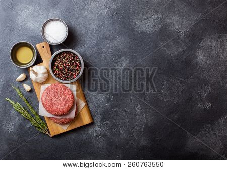 Raw Minced Homemade Grill Beef Burgers With Spices And Herbs. Top View And Space For Text. On Top Of