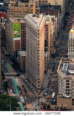 NEW YORK CITY - SEP 11: Flat Iron building, considered to be one of the first skyscrapers ever built, with New York City street aerial view. September 11, 2010 in Manhattan, New York City.