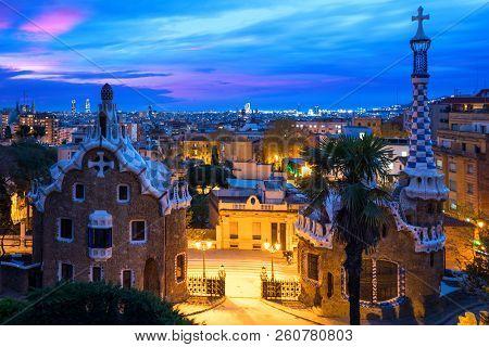 Park Guell In Barcelona, Spain At Night. Barcelona Skyline.