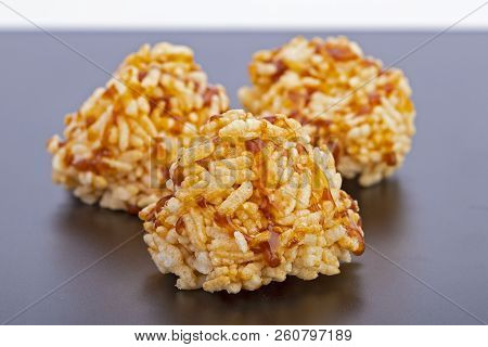 Thai Dessert - Rice Cracker Or Rice Biscuit Topping With Cane Sugar On Black Plate